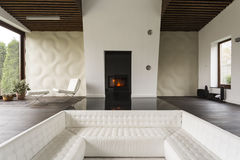 Tv living room with fireplace. And extra large white sofa stock photos
