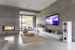 Tv living room with window. Fireplace and concrete wall effect Stock Images