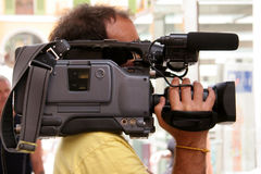 TV-man. Cameraman on the job Stock Photo