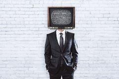 TV man on brick background with copyspace. TV headed businessman standing on brick background with copy space Stock Image