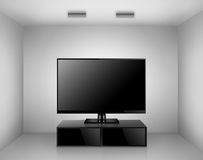 TV med TVställningen i ett rum Arkivbild