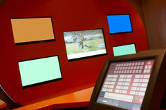 TV monitors in a bookmaking firm and bets Stock Photography