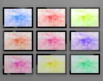 TV Monitors Wall Mounted In Different Colors Stock Image