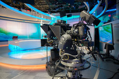 TV NEWS cast studio with camera and lights.  Royalty Free Stock Photo