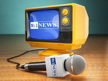 Tv news or report concept. Microphone and television. Stock Photo