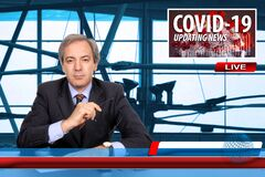 TV News screen with male anchorman reporting latest news on the novel pandemic coronavirus Covid-19