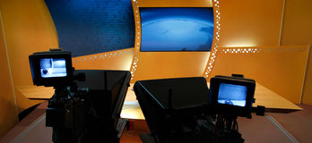 TV news studio. Television studio with news desk, camera prompter and professional lightning royalty free stock image