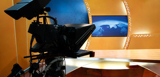 TV news studio. Television studio with news desk, camera prompter and professional lightning Stock Image