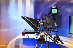 TV NEWS studio with camera and lights Stock Photos