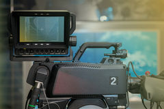TV NEWS studio with camera and lights. Shallow depth of field - focus on camera Royalty Free Stock Photography