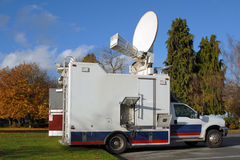 TV News Truck. A North American TV news truck in the fall royalty free stock photo