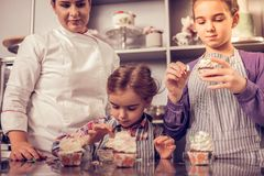 Nice cute girls participating in the cooking show royalty free stock photography