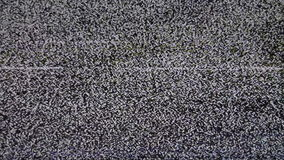 TV no signal. White Noize. Real Analog TV Noize. There is no signal, the TV reception is poor. Low signal level from analog antenna. Noise on the liquid-crystal stock footage
