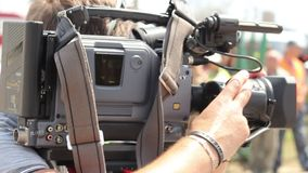 TV operator camera shoots report shots at day time, zooming. Stock footage stock video