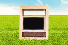 TV outdoor. TV with blank screen on the meadow. shot outdoor during summer Royalty Free Stock Photos