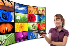 Tv-Panel with a woman. Big panel of TV, HD, movie, screen with remote control Royalty Free Stock Image
