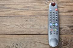 TV pilot do tv na drewnianym stole kosmos kopii Odgórny widok Obrazy Royalty Free
