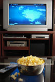 Tv and popcorn. Living room with tv and popcorn Royalty Free Stock Photo