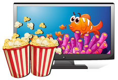 TV and popcorn Stock Photos
