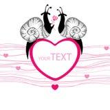 Två prack svarta sniglar med rosa hjärta Arkivfoto