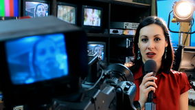 TV presenter latest news. Beautiful newscaster presenting news in TV studio,video clip stock video