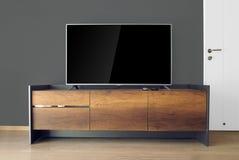 TV principale sul supporto della TV nella stanza vuota Immagine Stock