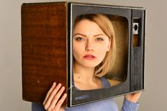 TV program. woman hold tv and choose any program. tv program for family time. tv program concept. enjoying her favorite stock images