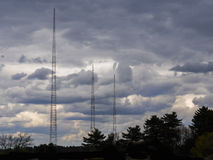 TV and radio antenna. Against a stormy sky Stock Photos