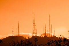 Microwave towers at sunset Stock Photography