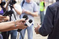 Media interview. TV or radio reporters interview Stock Image