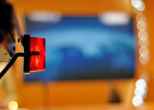 TV red light. Red light lamp in television studio Royalty Free Stock Image