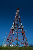 Telecom broadcasting tower under blue sky Royalty Free Stock Photo