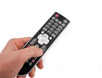 TV remote. Hand holding a TV remote royalty free stock image