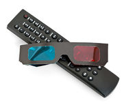 TV remote 3D glasses. Details of a television remote controller and 3D movie glasses.  White background Stock Photo