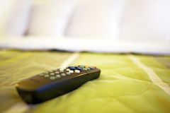 TV Remote on Bed Royalty Free Stock Photography