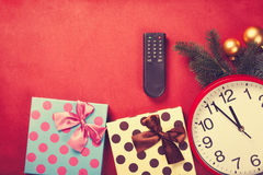 TV remote and christmas gifts Stock Images