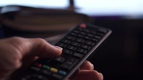 TV remote close up, 7 videos in 1 stock video footage