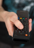 TV remote control. Hand holding TV remote control Stock Image
