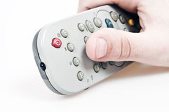 Tv remote control. Male hand holding tv remote control Royalty Free Stock Image