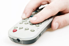 Tv remote control. Male hand holding tv remote control Royalty Free Stock Images