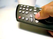 TV remote control. Hand press the remote button stock photography