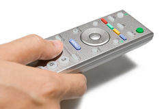 TV Remote Control. Closeup of hand with TV remote control on white background Royalty Free Stock Photography