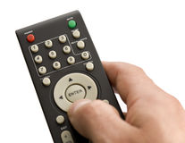TV remote control. Close up of hand operating a TV remote control royalty free stock image