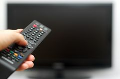 TV remote control. Switching on tv with remote control in hand Stock Photo