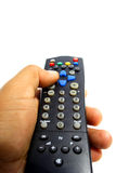 TV remote control. A hand press the button on TV remote control Royalty Free Stock Images