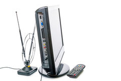 TV with remote control and antenna Stock Photography