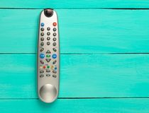 The TV remote control on a blue wooden background. Top view.  Royalty Free Stock Image