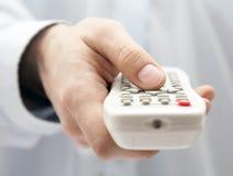Tv remote control in hand. White plastic tv remote control in hand Stock Photos