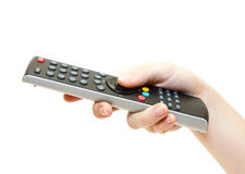 TV remote control in hand Royalty Free Stock Images