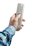 TV remote control in hand Stock Photo